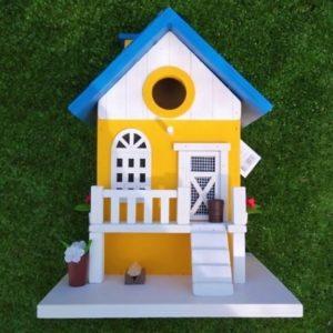 casa para pajaros amarilla